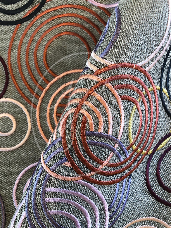 INTERLOCKING RINGS  Satin stitch outlines on heavy linen.