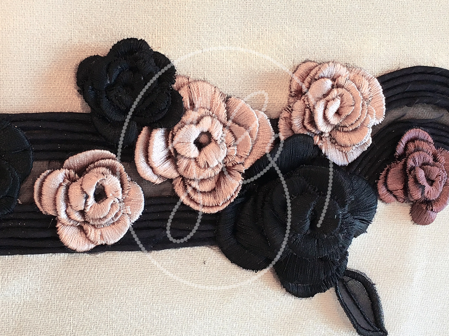 CAMELLIAS WITH CORDING  Fabric corded, manipulated and embellished with 3D camellias.