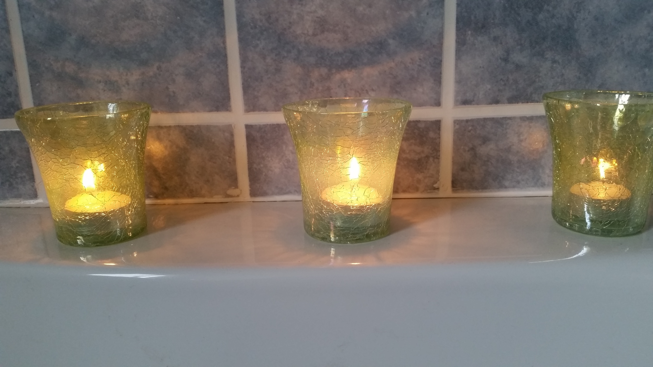Three candles in the washroom