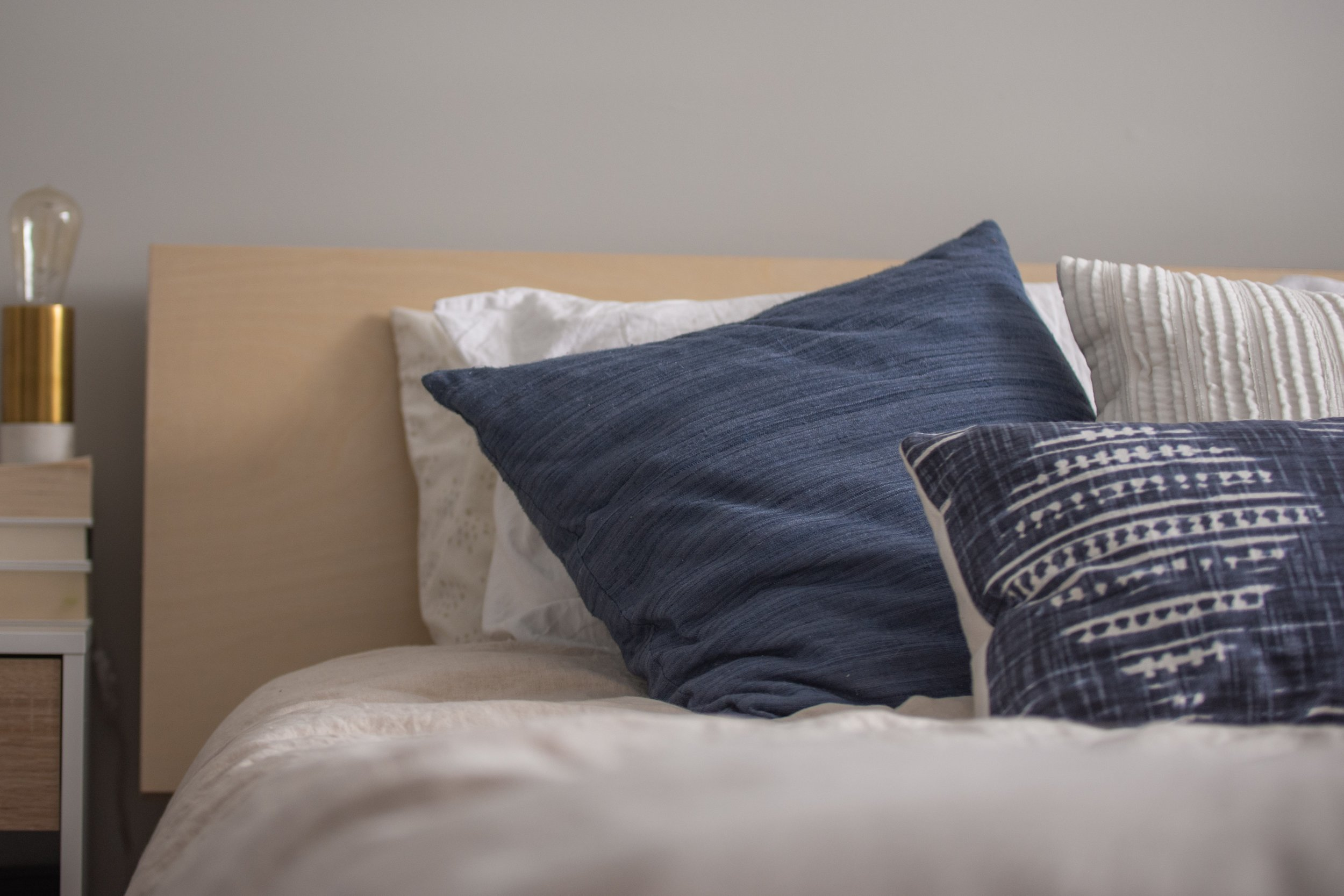 Velvet and Cotton Pillows on a Bed.jpg
