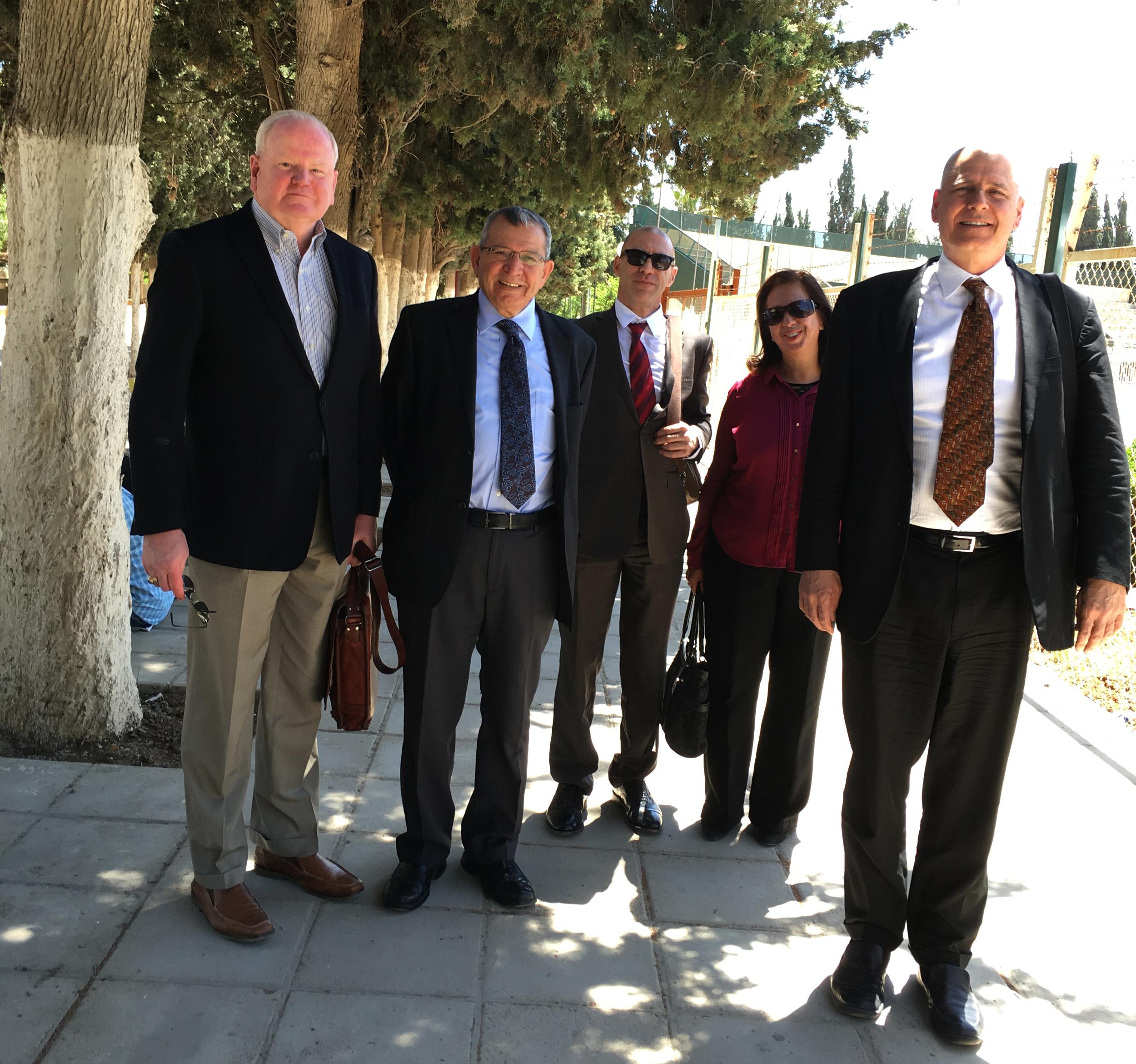 Maj Gen (Ret) Charles E. Tucker, Dr. Mahmoud Duwairi, Craig Coletta, Sawsan Alfayez, and Dr. Eric Woltertorff on the University of Jordan campus.