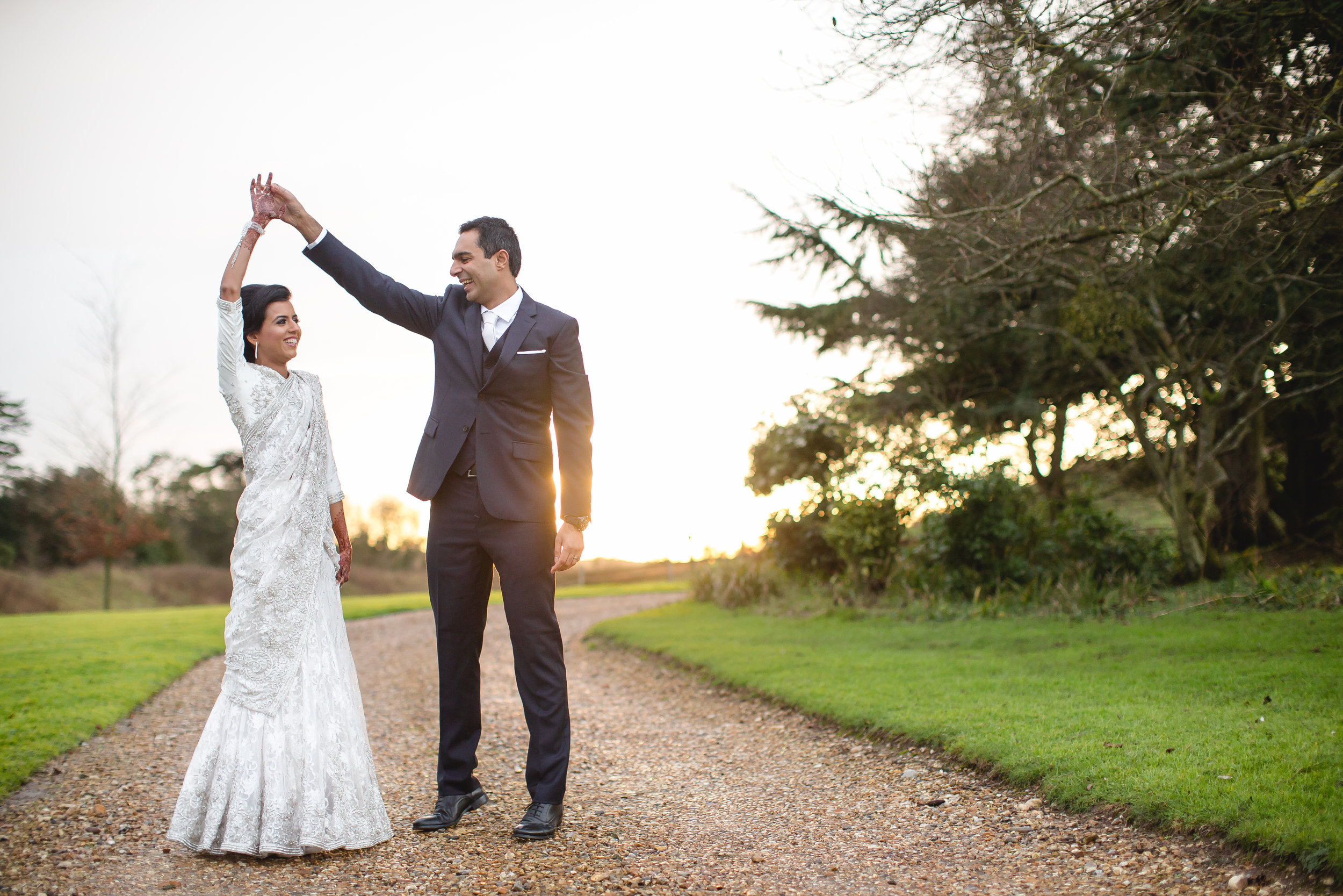 sunset couple portrait asian wedding at northbrook park