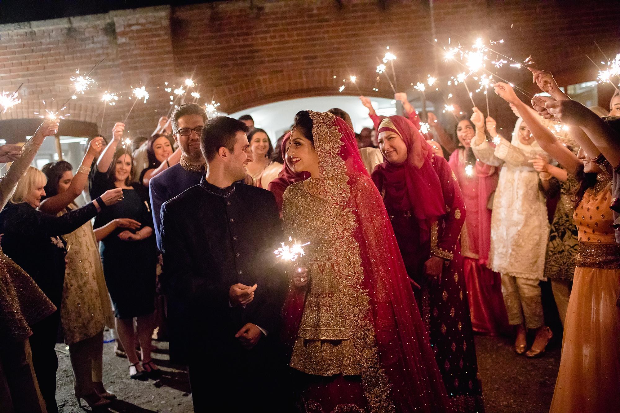 Pakistani Bride sparkler exit rukhsati at Tatton Park wedding Cheshire