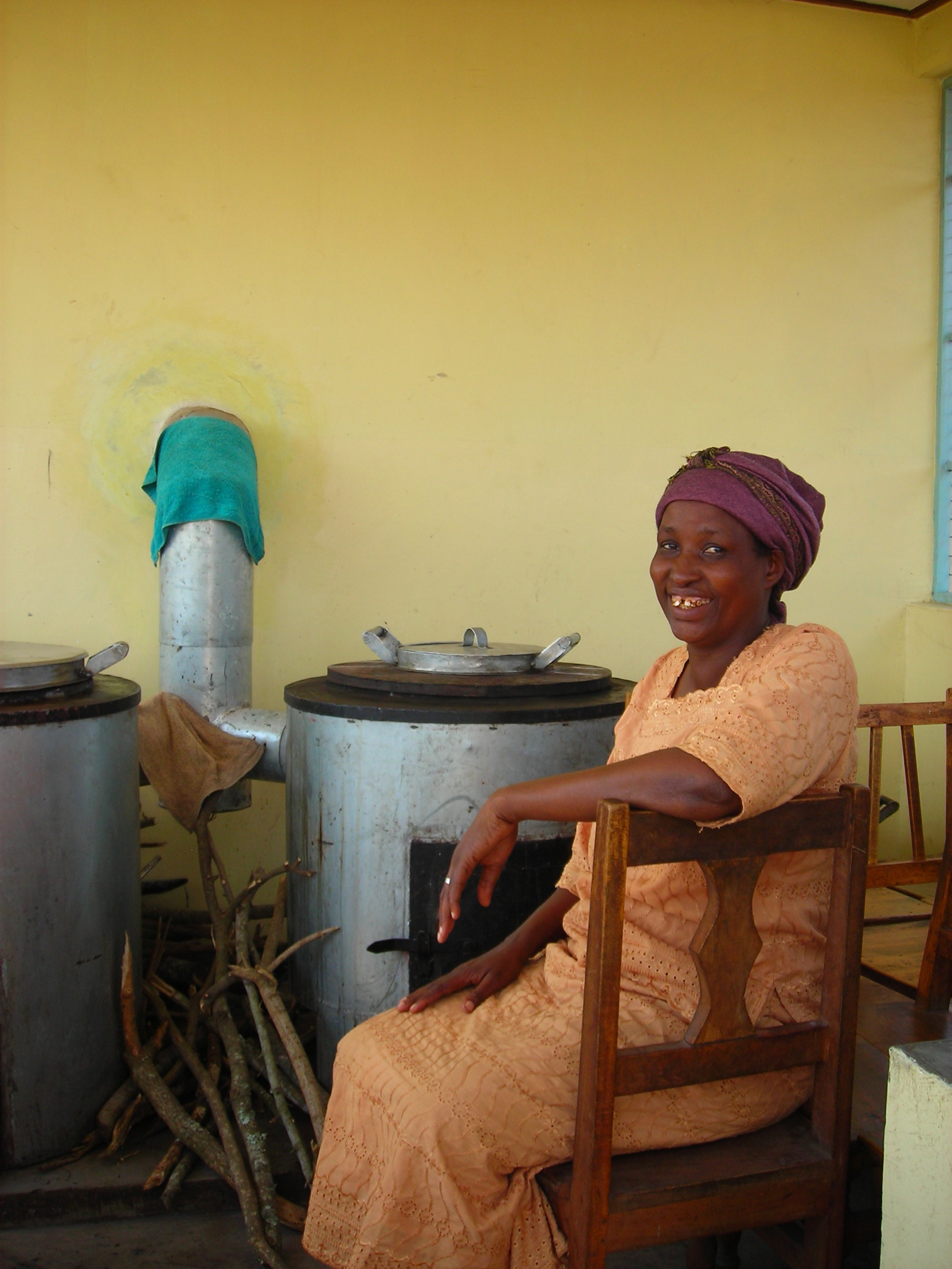 Happy teacher with new stoves.JPG