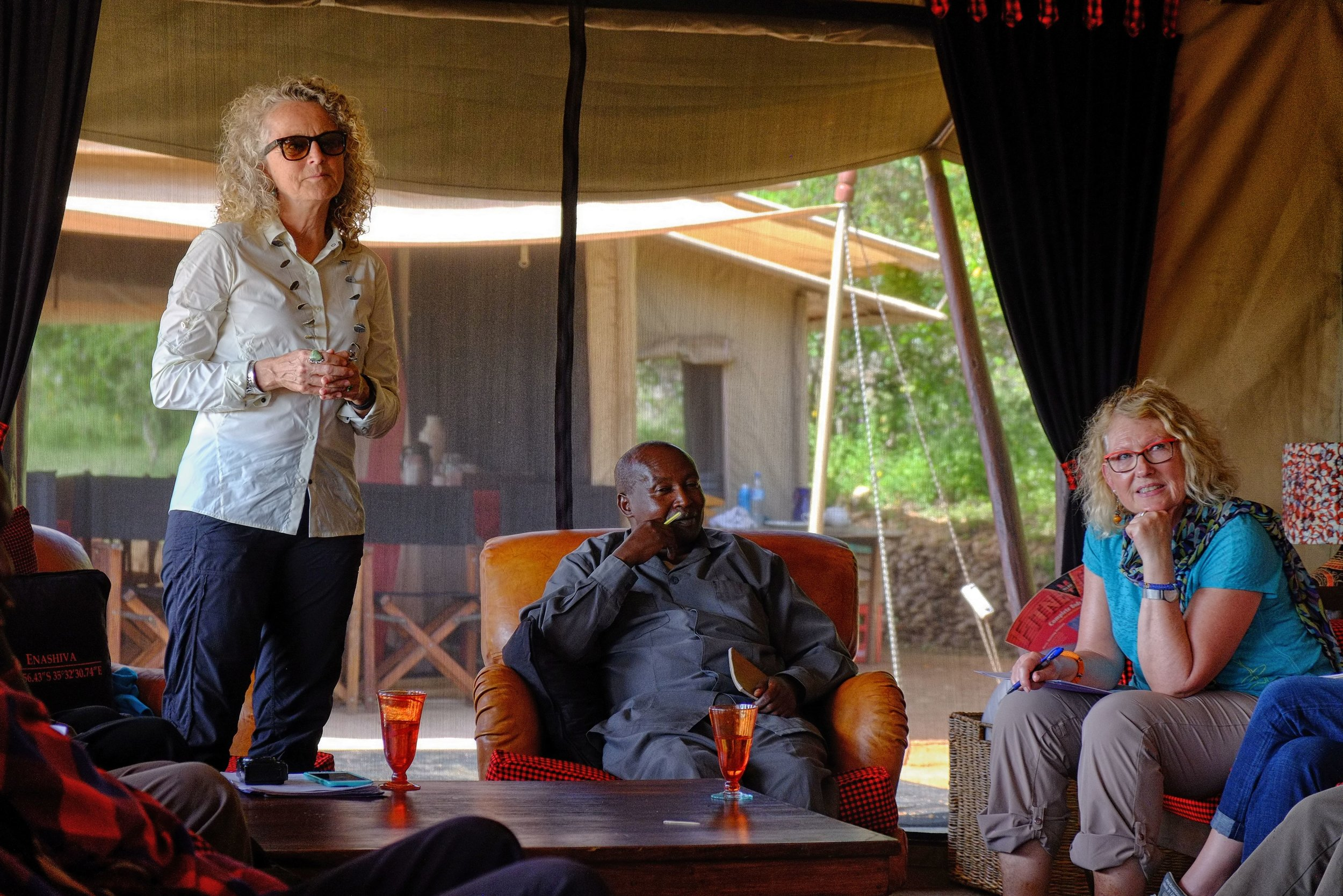 Board Members Judi Wineland and Karen Dial sit on either side of    Ward Councilor for the   Oloipiri Ward,   William Alias during a meeting with Oliopiri Elders.