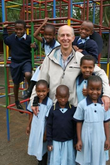 Bob Treitman spending some time with the children of Tanzania during a visit to Tanzania.