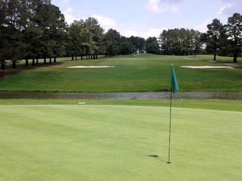 Hole #2, par 4- The shortest par 4 on the course. Big hitters can take a shot at clearing the pond off the tee. The bunkers are strategically placed, making for a tough 80 yard shot over the water.