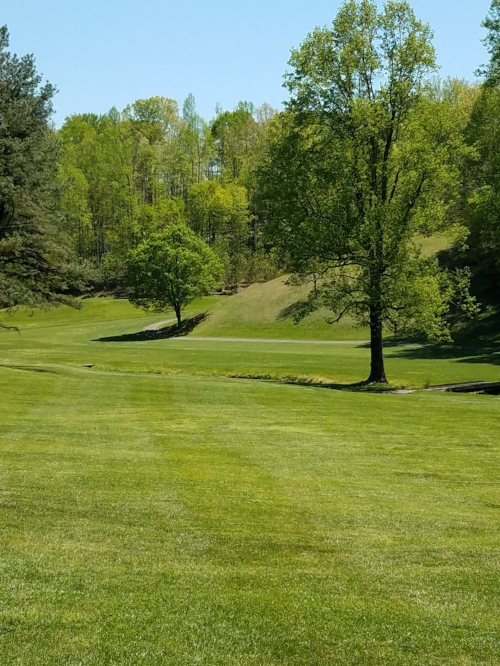 Hole #3,par 4- You won't see the flag from the tee box or maybe your second shot as well. Dogleg to the right. Precise shot needed to a fairway that is only 20 yards wide. Most players will have to play a blind shot over a menacing hill. Multiple looks on this hole.