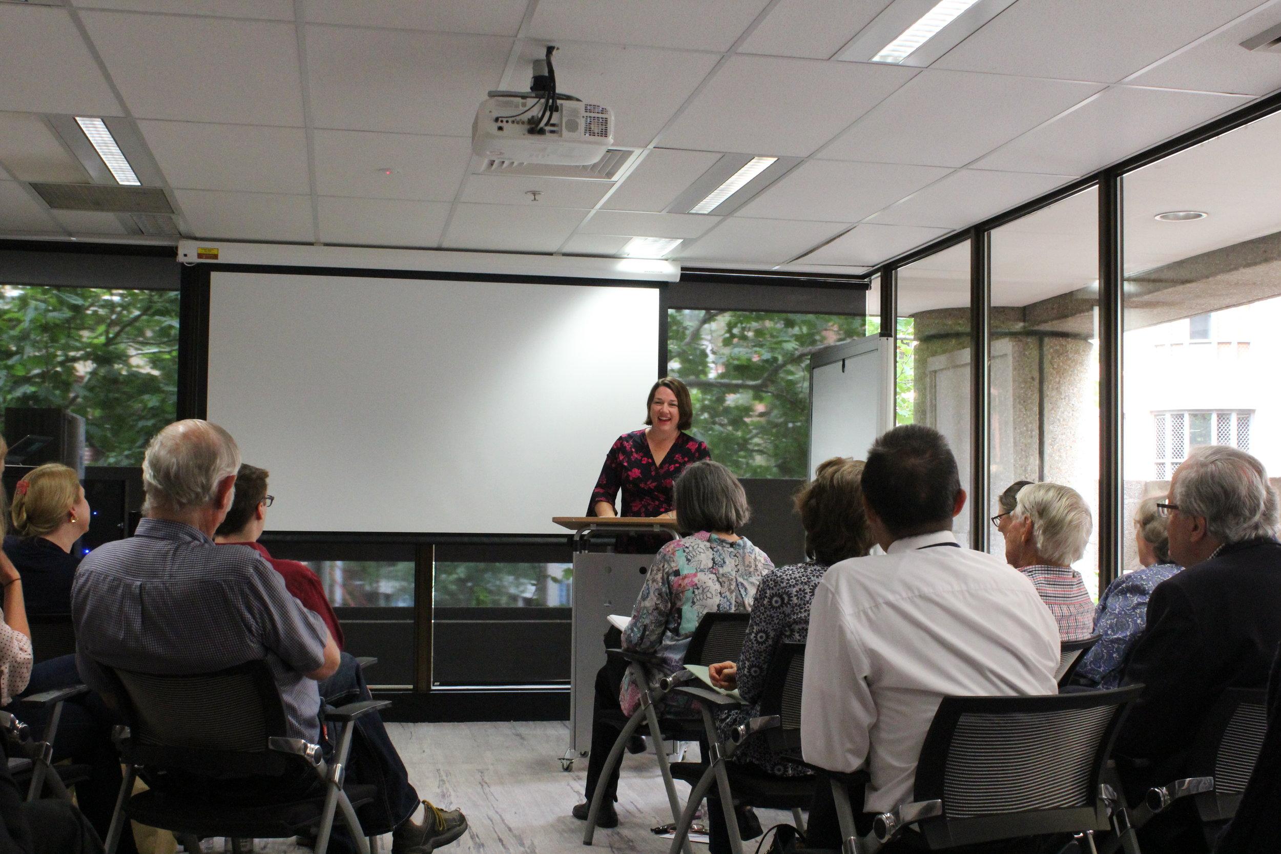 Sarah Morse reads her poem at The Hub graduation in December 2017.