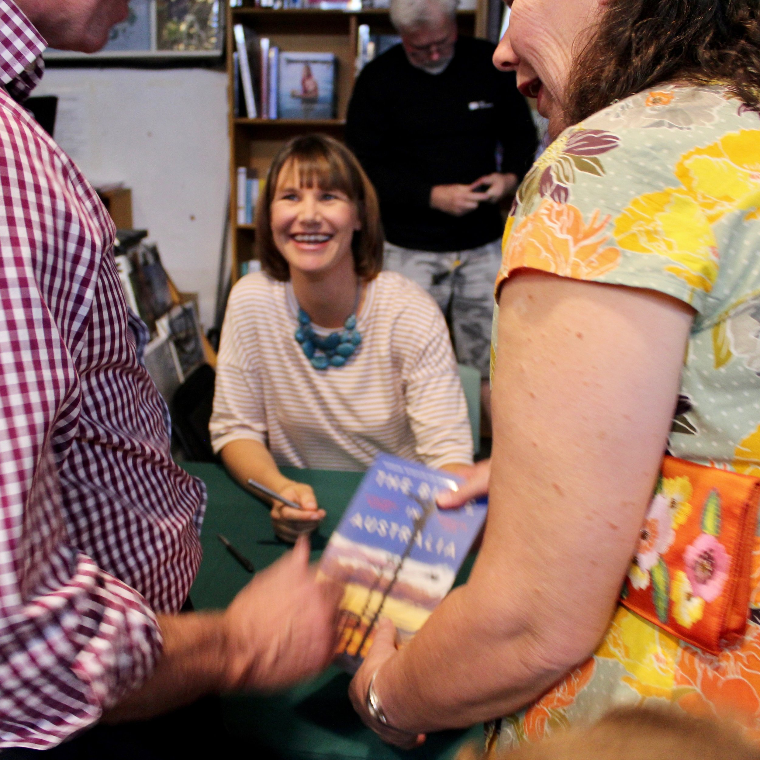 Meredith signing copies of her book at the launch.