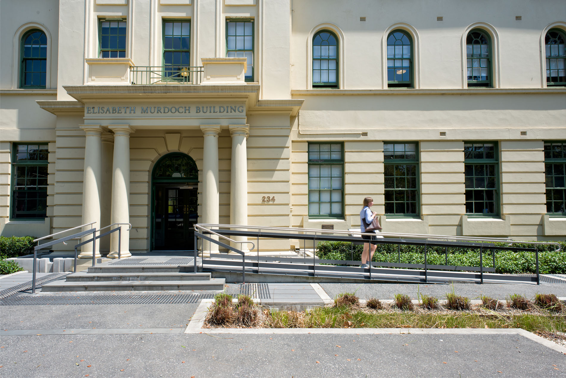 CLIENT  |     University of Melbourne/VCA     LOCATION  |      South Melbourne     COMPLETED  |      2     VALUE  |      $6m      The Elizabeth Murdoch building is effectively the 'front door' of the Melbourne University's Victorian College of the Arts (VCA) campus. It houses the main administration area, research functions and student centre, as well as the main multi-media presentation space for the VCA. Both the Dean and Head of School are located in this building.  The $6m project, involved the staged refurbishment of the former police barracks, a building listed on the Victorian Heritage Register. Our brief was to incorporate all the required functional areas and equip the building appropriate for future teaching practices, as well as improving access for people with disabilities.  A key challenge involved the incorporation of the new IT infrastructure. Our efficient planning strategy enabled the Finance Department to be collocated with the other administrative areas, so that the post-graduate research area could be located on the top floor.  Further, the VCA sought from us a design that gave them a strong sense of identity, within the historic structure, expressing the creativity and integrity of their programme. Working within a very tight budget, our design is characterised by carefully crafted materials and finishes, providing positive and energising spaces throughout, that work well with the historic fabric of the building.