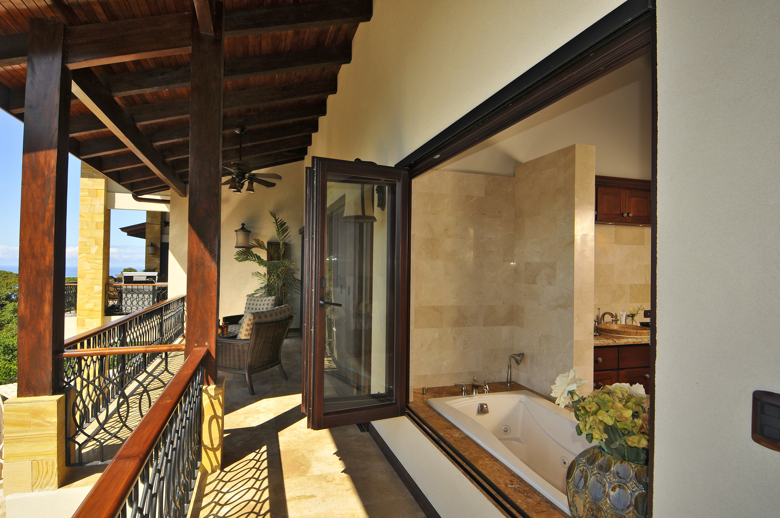 flex5-yoga-retreat-costa-rica-villa-king-suite-bedroom-balcony.jpg