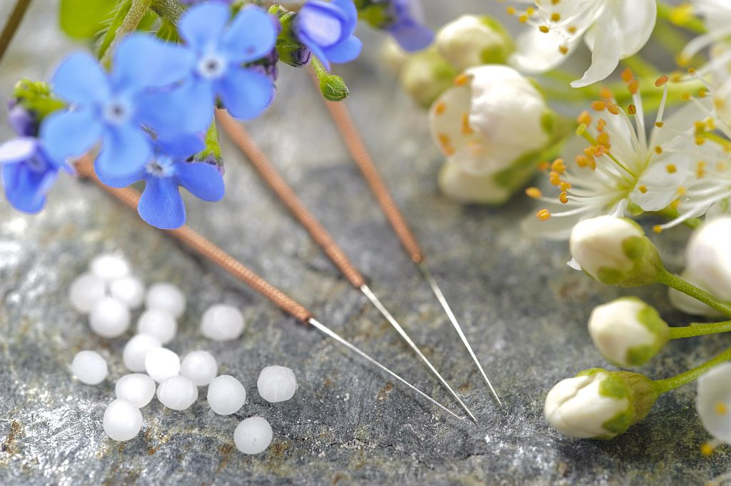 alternative medicine with pills and acupuncture