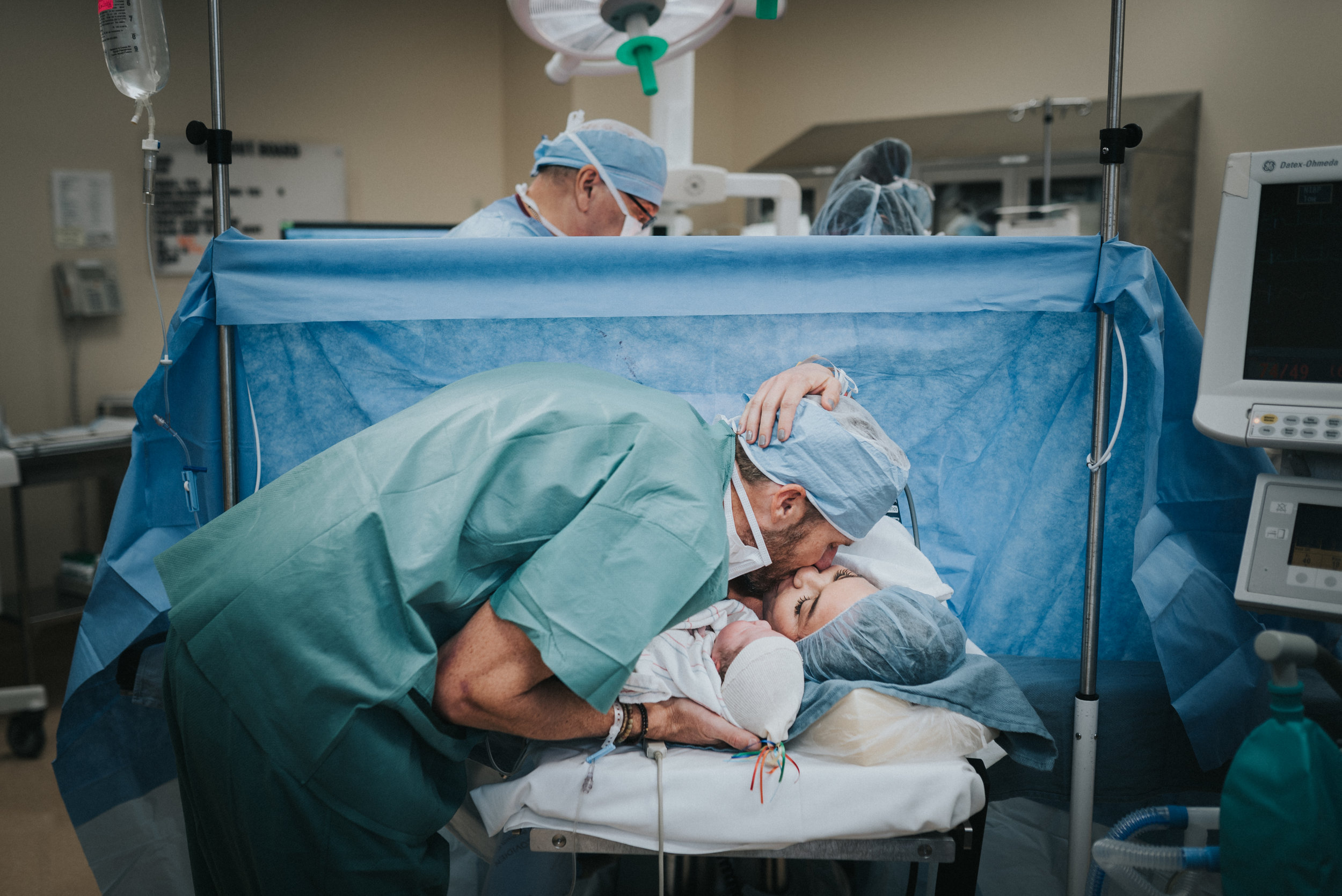 The first kiss between new mother and father after a cesarean at Scottsdale Shea Hospital.