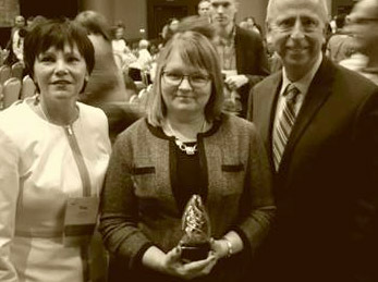 Pegg Gustafson, St. Cloud Downtown Council President, Jill Magelssen, St. Cloud Rotary President, and Dave Kleis, Mayor of St. Cloud with the IDA Downtown Achievement award.