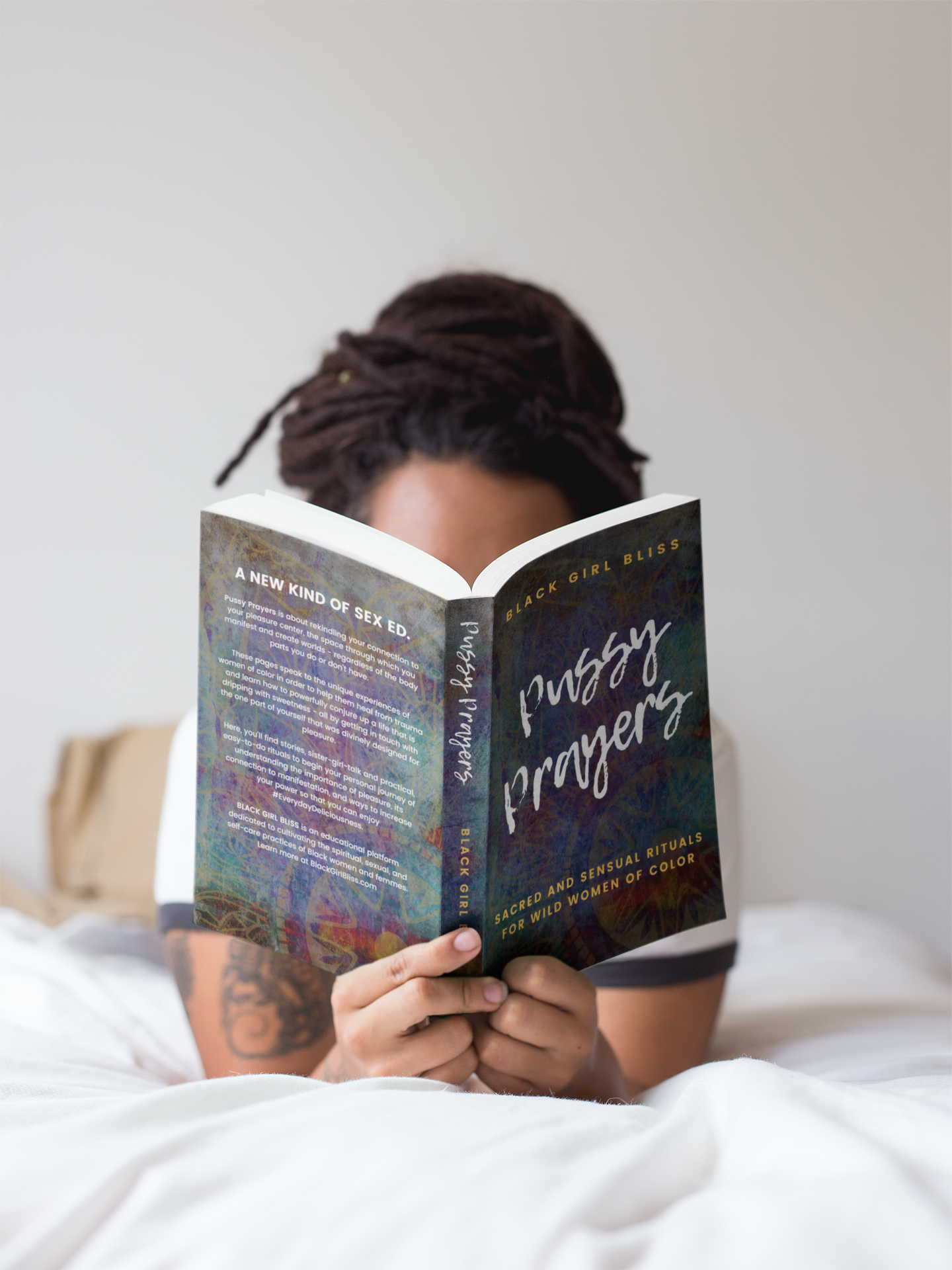 girl-with-dreadlocks-reading-a-book-mockup-while-in-bed-a17301.png