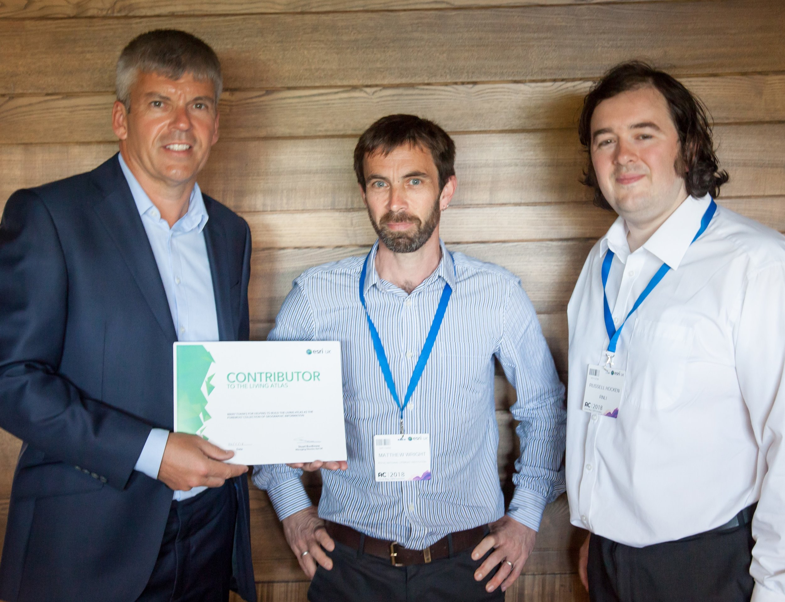 Left to right: Tim Welch, general manager at esri uk, thanking matthew wright, russell hocken and lee muttock (not pictured), from rnli, for their help with the conference