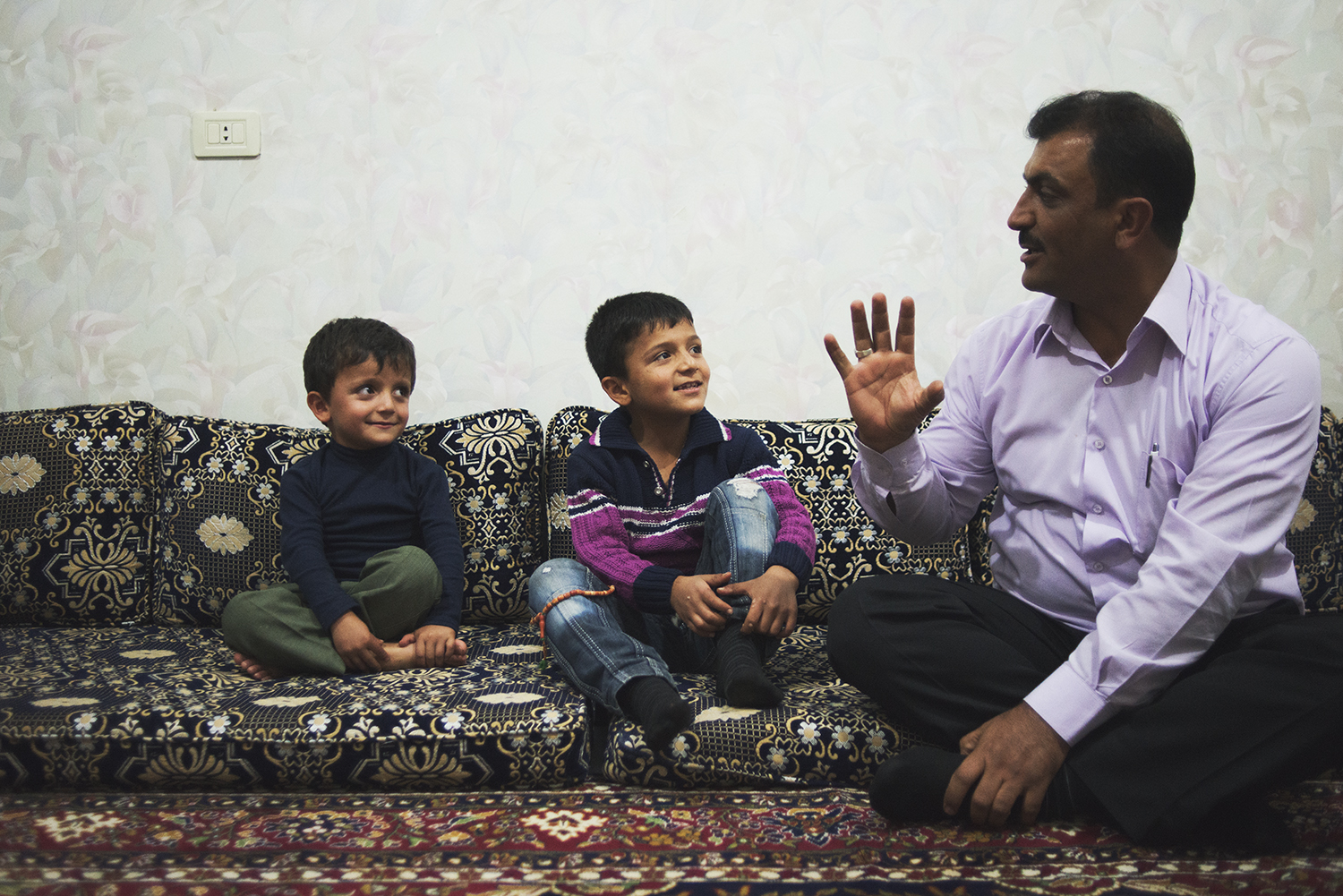 a father and sons.Tall Rifat, Syria. 2012   ©    Go Nakamura     photography