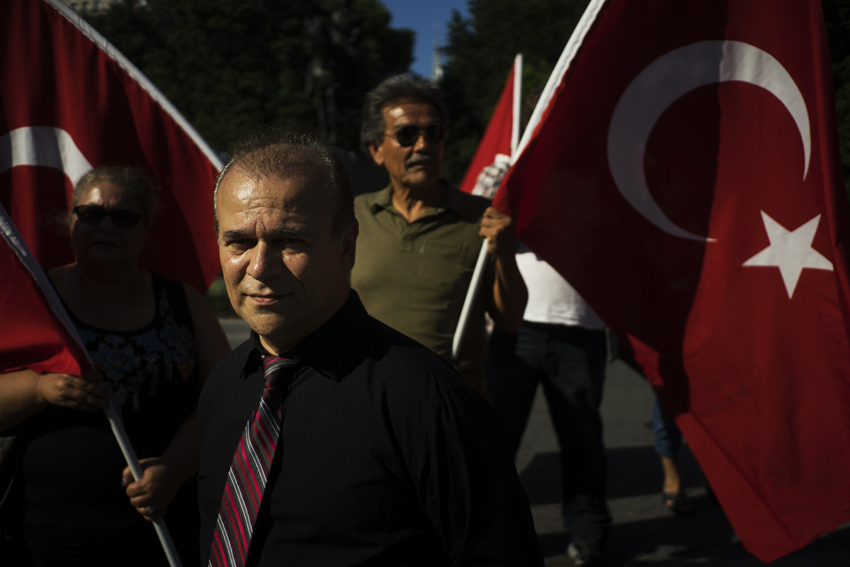 a small group of demonstrators raise Turkish flags in Union Square to protest against recent terror attacks in Turkey.  Manhattan, NY. 2016 ©Go Nakamura photography