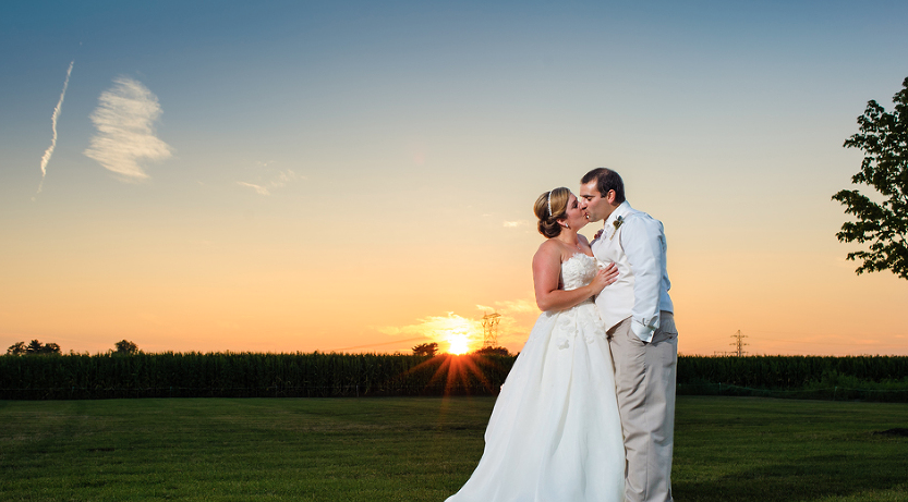 bride and groom at sunset.png
