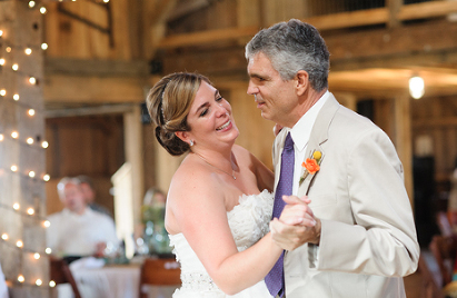 father daughter dance at barn wedding.png