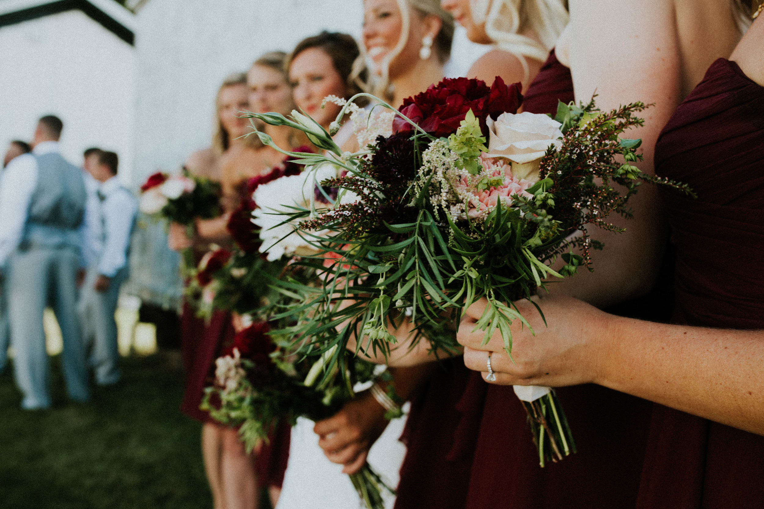 greenery with red and pink floral bouquet.jpg
