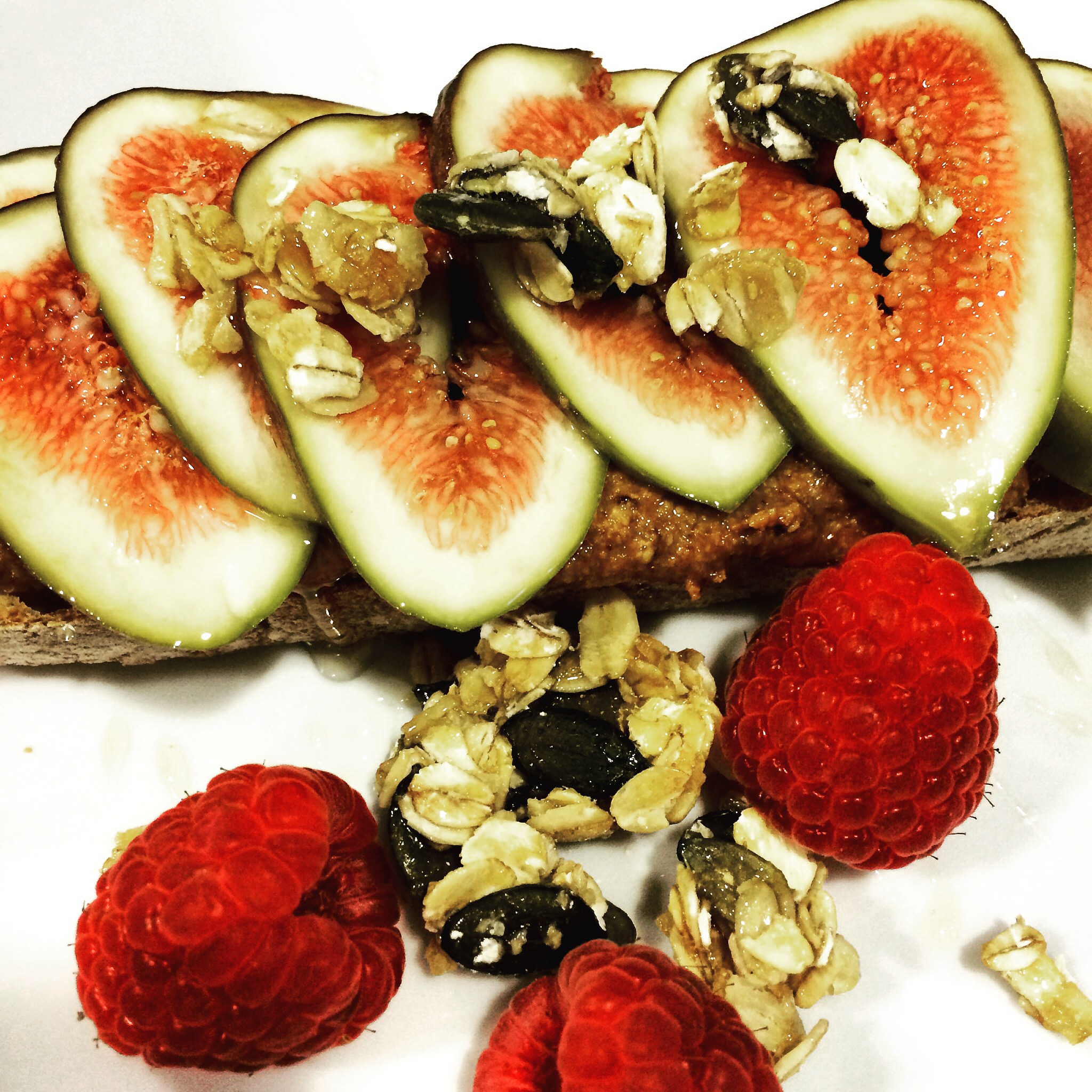 Homemade almond butter toast with fresh figs and granola