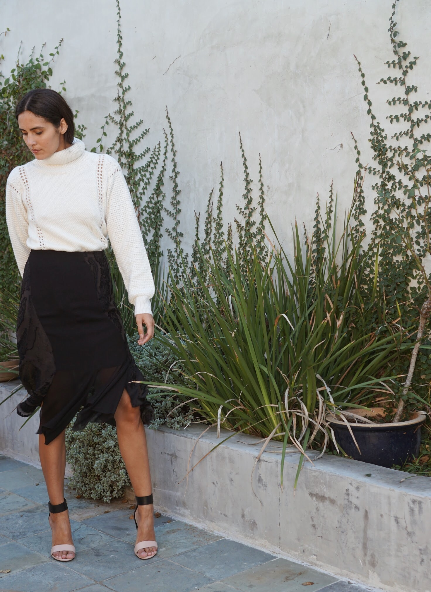 Maiyet Turtleneck in Ivory +  Maiyet  Fil Coupe Panel Skirt in Black.