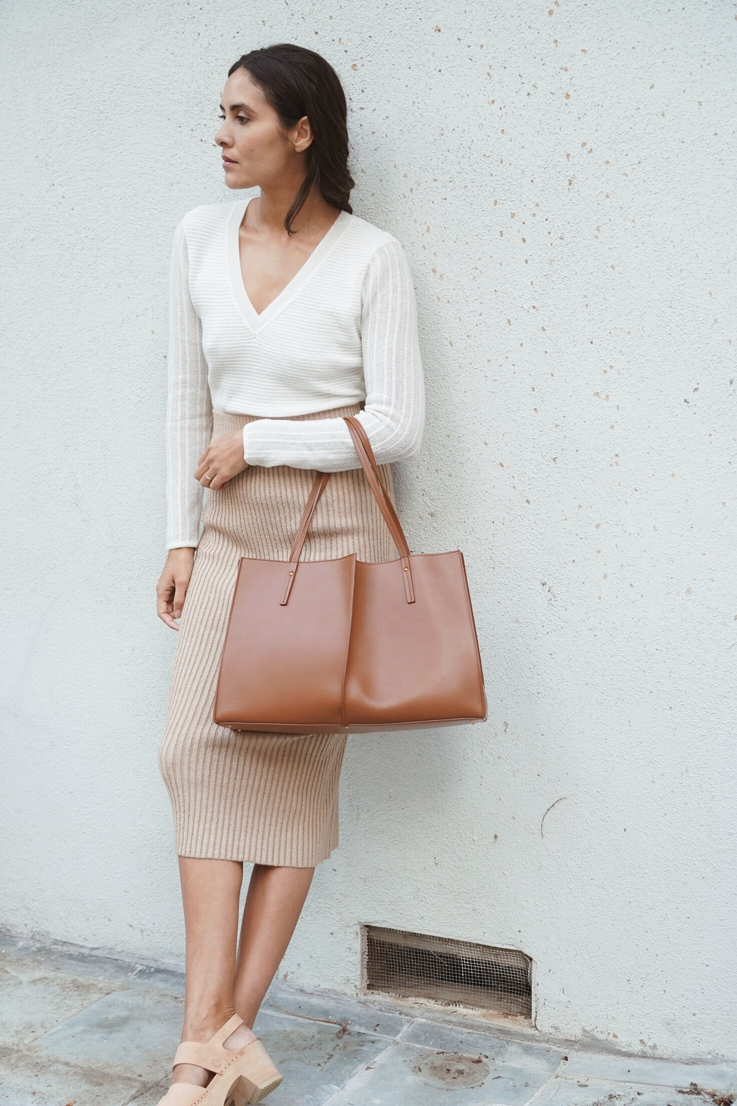 Maiyet  Knit Stripe V Neck in Ivory +  Eleven Six  Rib Tube Skirt in Nude +  Maiyet  Sia East/West in Cognac +   Zuzii   Closed Toe Clogs in Natural.