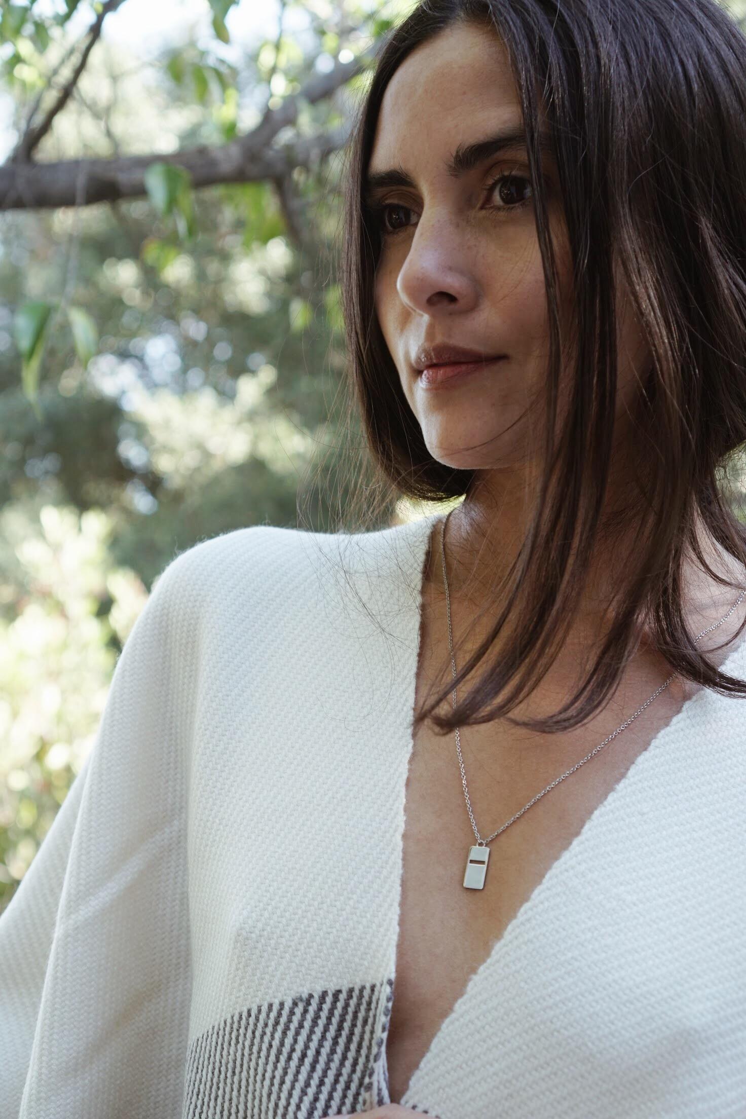 Sandrine  Xing Pendant +  Maiyet  Stripe Hem Poncho in Ivory.