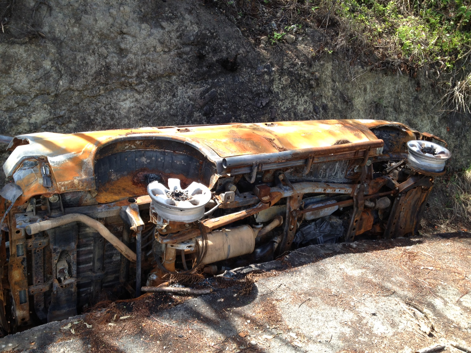 Car overturned in a rainditch along a road in Saint Lucia
