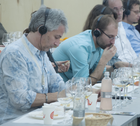 Avid concentration happens in multiple language at one of the wine tastings at Salone del Gusto
