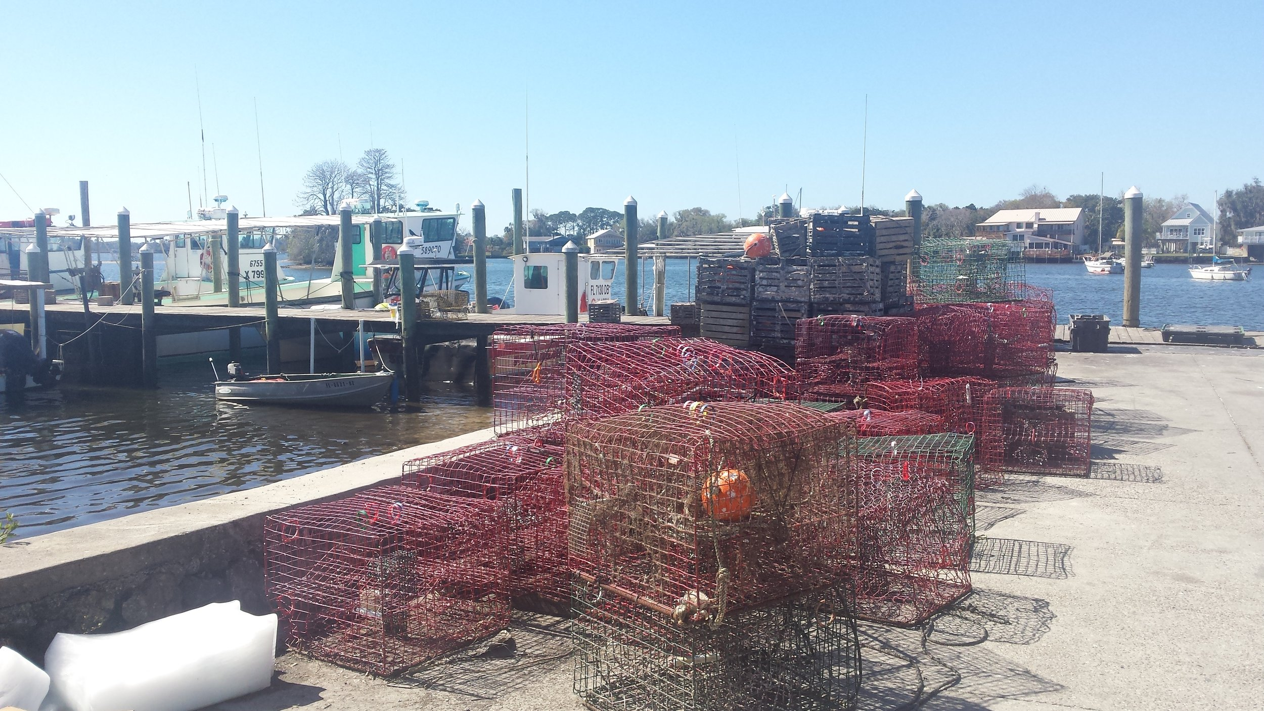 Crab traps stacked on the pier in Kings Bay