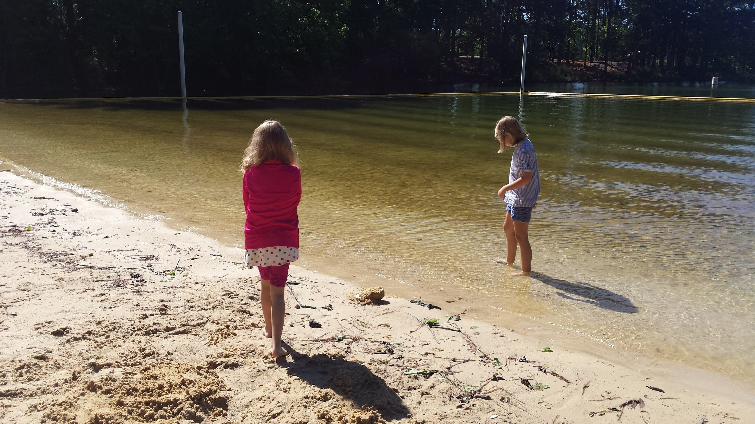 Kids like the beach even if it is rainy and cool. The sun made a brief appearance for us!