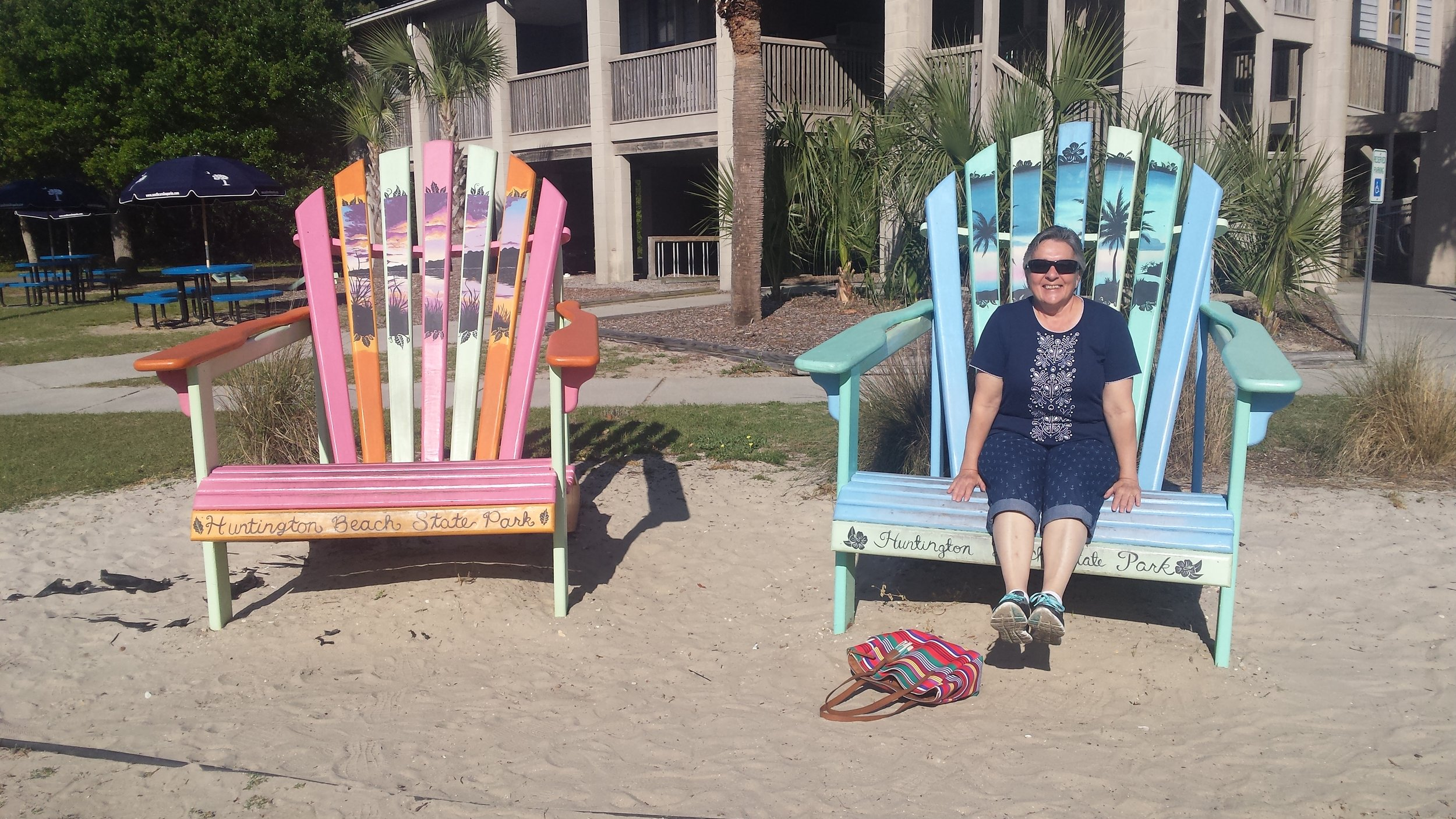 Beach Nana chilling in the giant adirondack chairs at Huntington Island State Park.