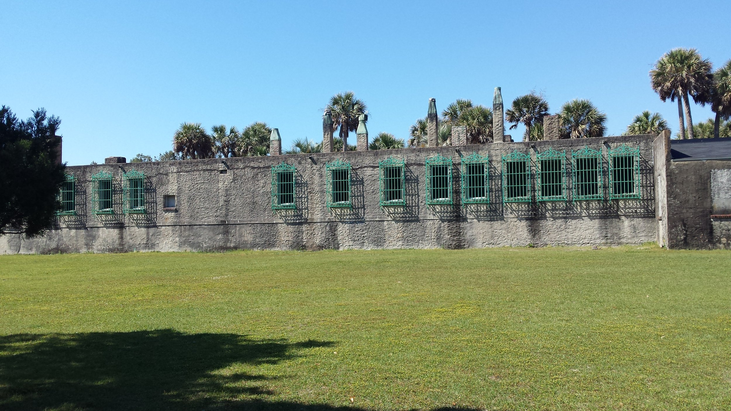 Atalaya Castle with hurricane grates designed by Anna Hyatt Huntington'