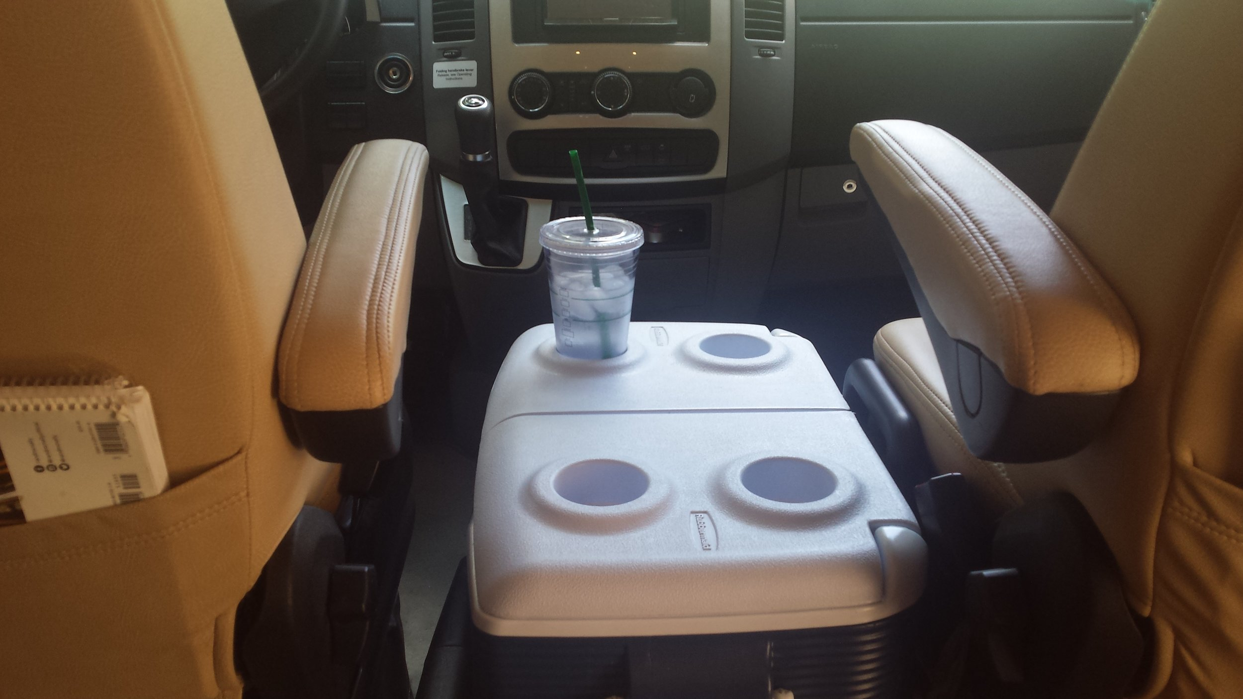A cooler is a great way to increase storage in an RV and it can double as a table between the front seats