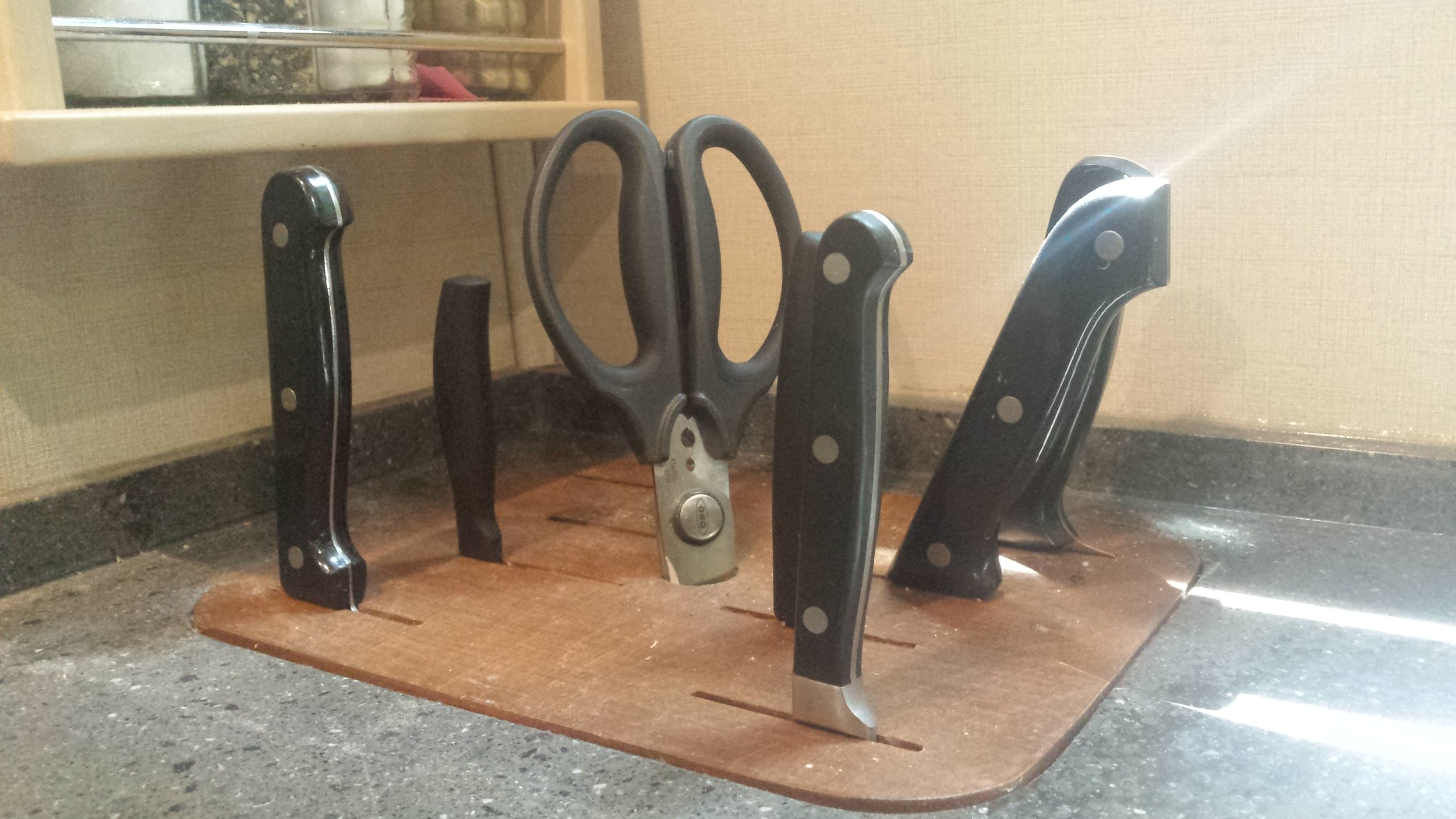 A knife block insert for the RV kitchen counter