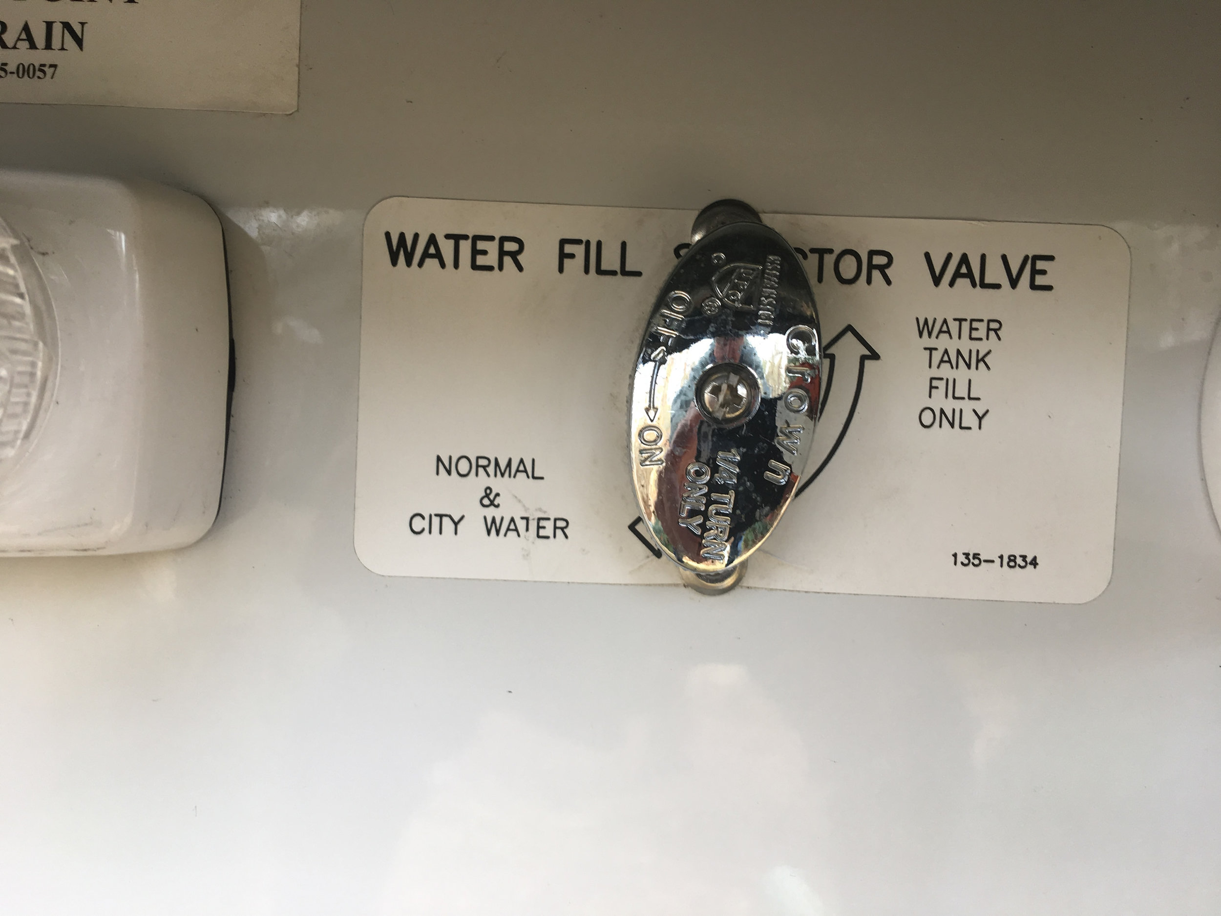 """Fill the water tank from a faucet using the """"water tank fill"""" position."""