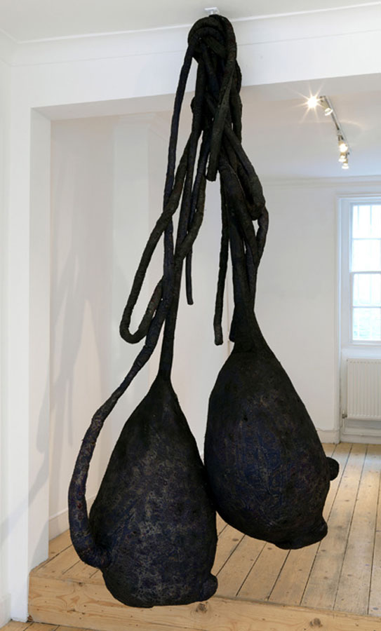 Saad Qureshi,  As Fate Would Have It , burnt prayer rug and coal (2010)  http://www.saadqureshi.com/#/sculpture