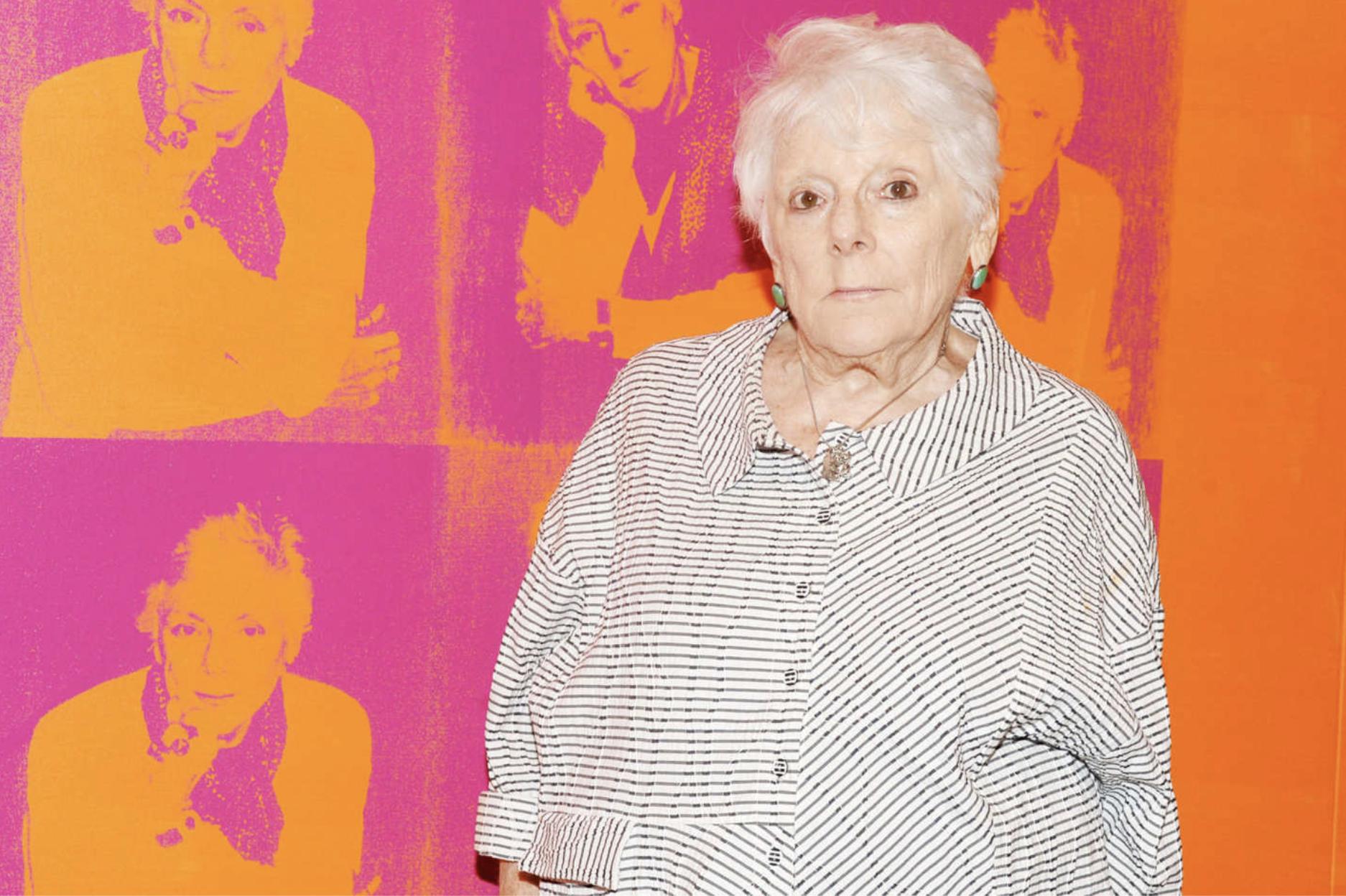Linda Nochlin, standing in front of Deborah Kass's 1997 work  Orange Disaster (Linda Nochlin).