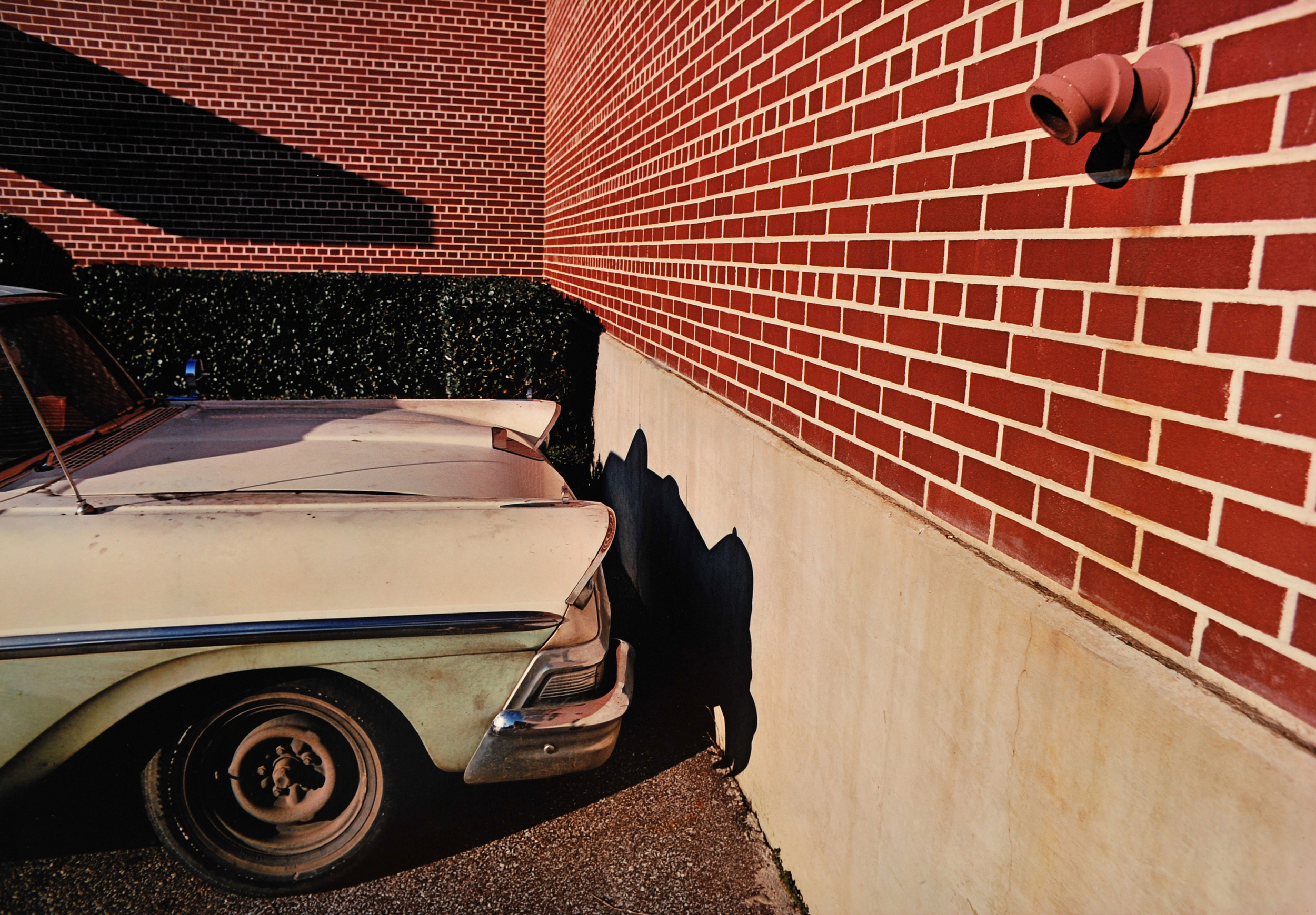 """William Eggleston, Untitled (White Car, Brick Wall),  from """"14 Pictures,"""" 1974.  http://www.rosegallery.net/eggleston/exhibitions/williameggleston/"""