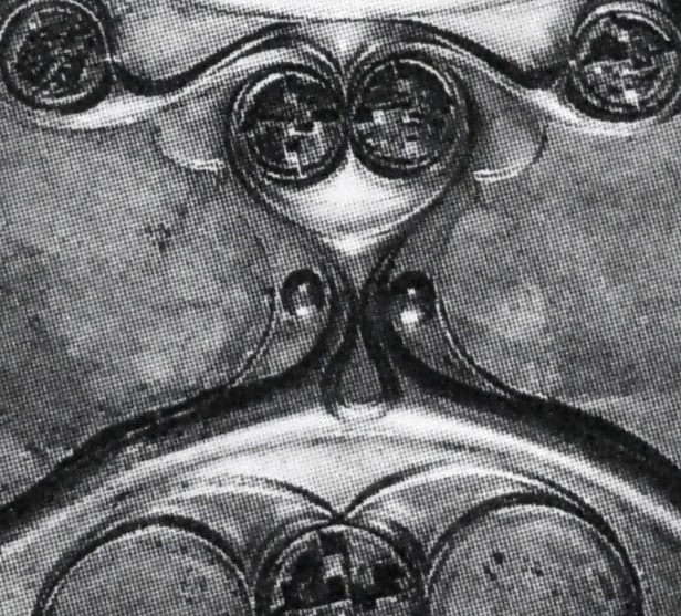 Detail from the  Battersea Shield  featuring a 'Cheshire Cat' face. Second/first century BCE. Bronze repoussé and red enamel. British Museum, London. Image Source: Megaw & Megaw, 2001
