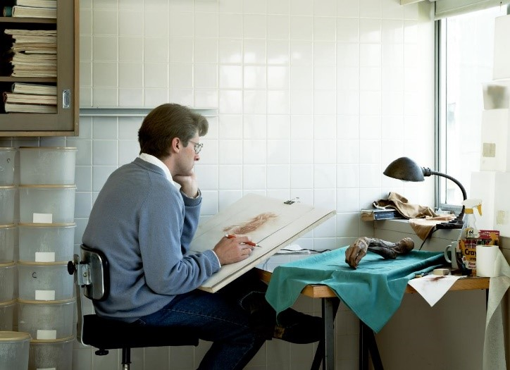 Jeff Wall,  Adrian Walker, artist, Drawing from a specimen in a laboratory in the Dept. of Anatomy at the University of British Columbia,  1992. 119 x 164 cm, Transparency in Lightbox, National Gallery of Victoria  https://www.ngv.vic.gov.au/exhibition/jeff-wall-photographs/