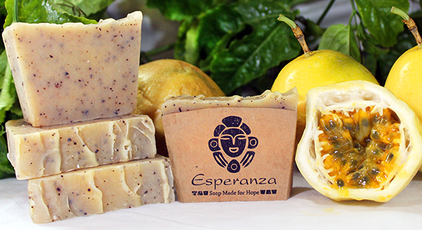 """Passion Fruit Soap - The typical Dominican """"chinola"""" in a fresh, citrus soap. Made with Honey, Orange and Lemon essential oils, and crushed passion fruit seeds for a strong exfoliation."""