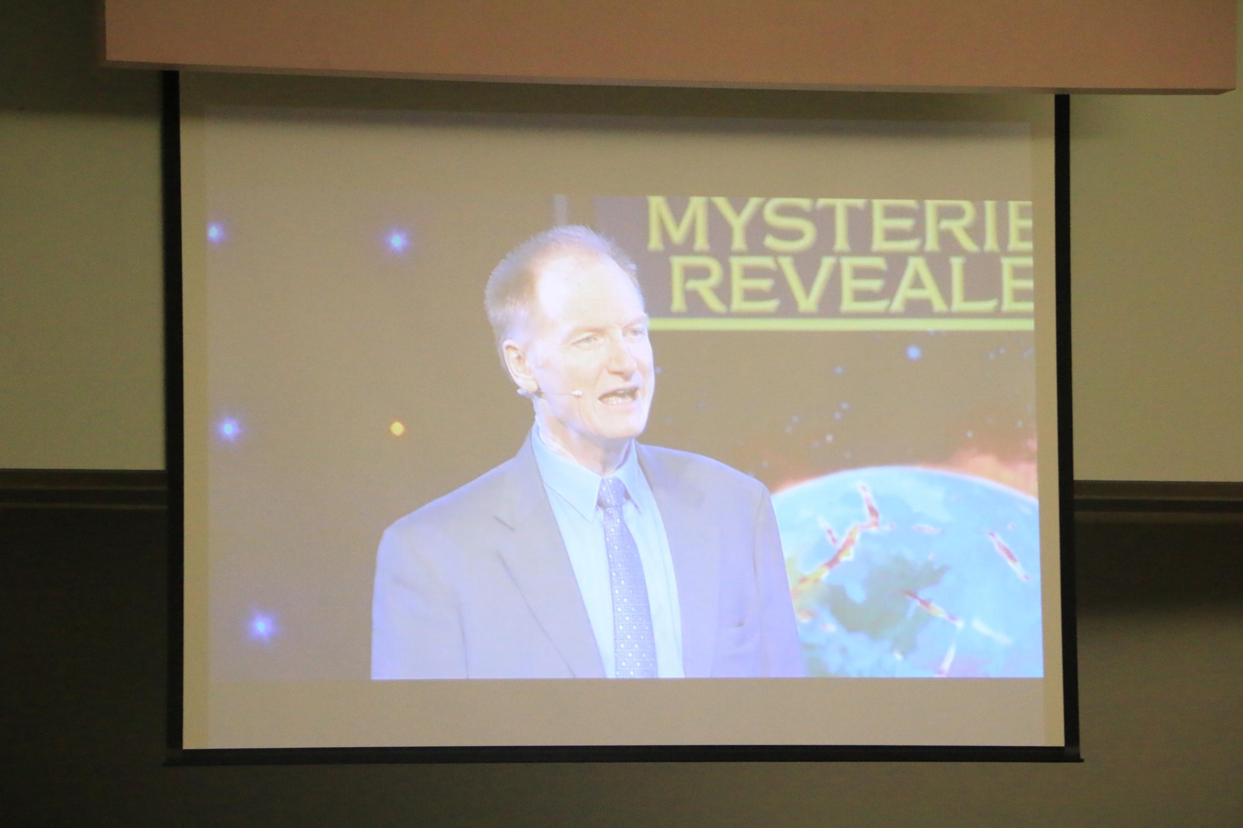 It Is Written Speaker/Director John Bradshaw addresses the audience via video.