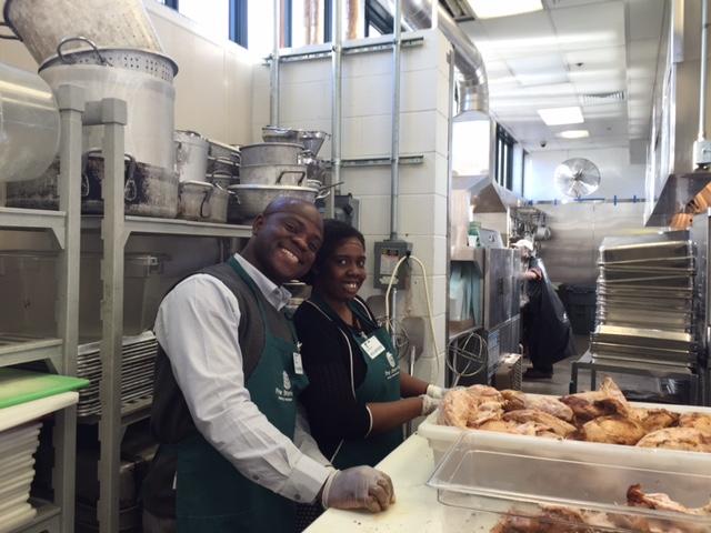 Volunteers serve food at the Pine Street Inn.