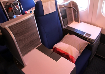 Business class seats transform into a lie-down bed at the flick of a switch. © Joanne DiBona