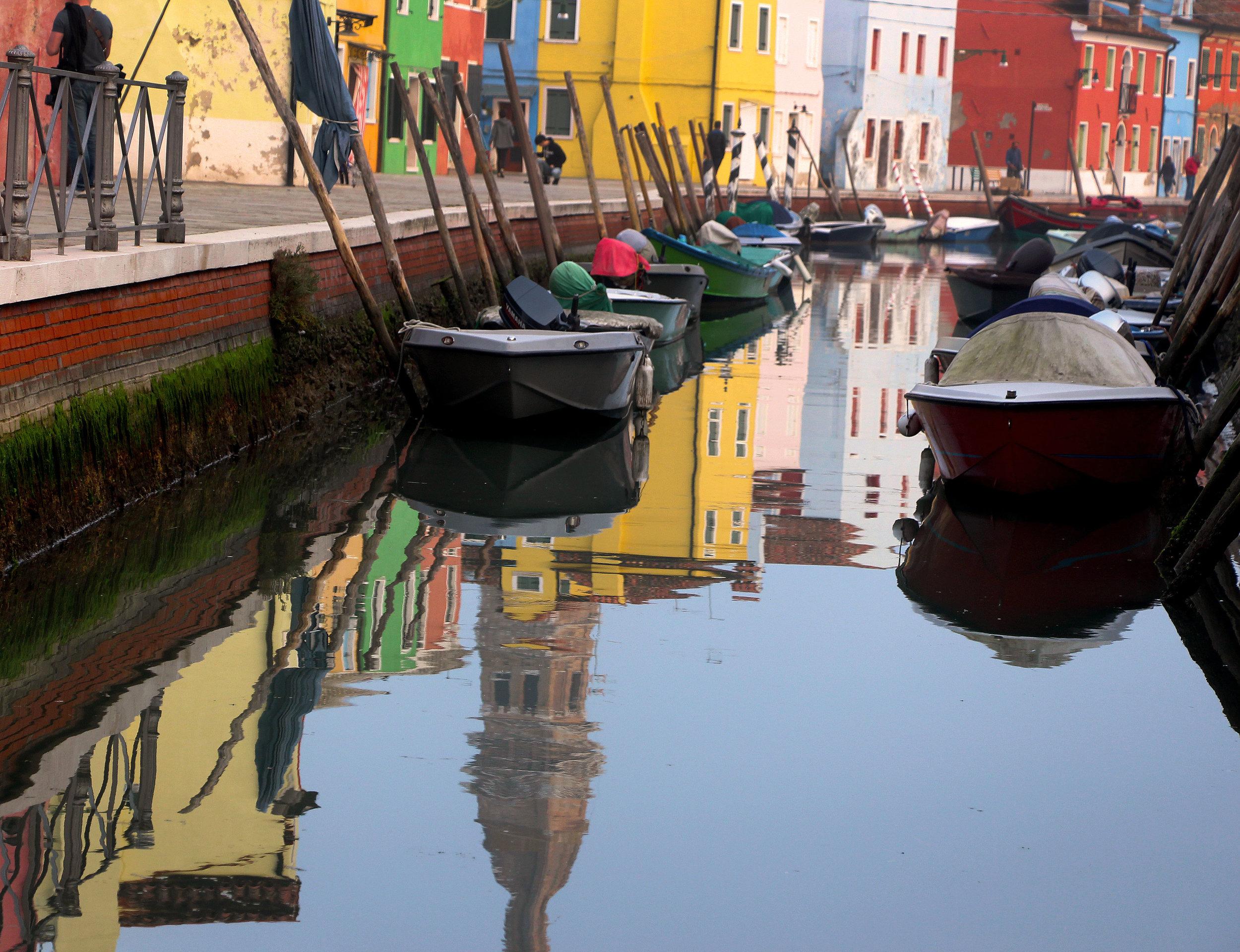 Reflections in the canal of Burano, Italy   © Tony DiBona