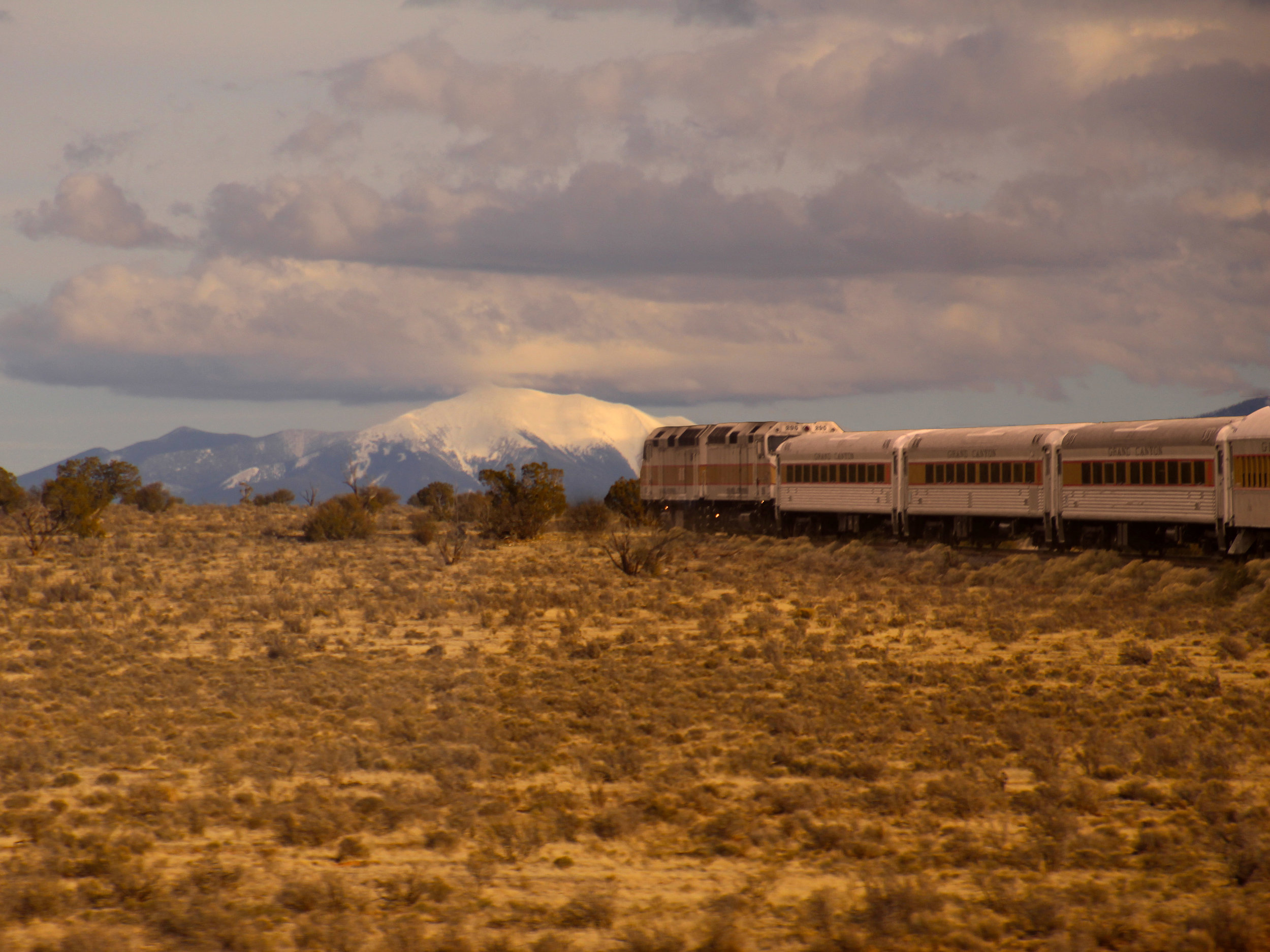 The Grand Canyon Railway makes its way across the plains en route to the Grand Canyon's South Rim  © Joanne DiBona Photography